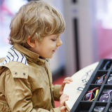 Cute little kid boy at optician store during choosing his new gl Stock Photos