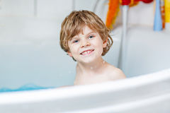 Cute little kid boy playing with soap in bathtub Royalty Free Stock Photo