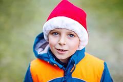 Cute little kid boy with Santa Claus hat Royalty Free Stock Images