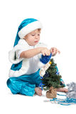 Cute little kid decorating Christmas tree Royalty Free Stock Photo