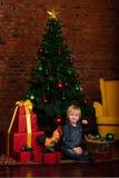 Cute little kid decorating Christmas tree Stock Photo