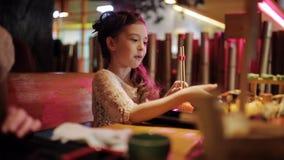 Big set on sushi and rolls on the restaurant plate. Family dinner at pan-Asian restaurant. Little girl eating rolls with. Cute little kid girl in restaurant stock video