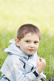 Cute little kid in grass Royalty Free Stock Images