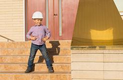 Cute Little Kid in Helmet Posing at the Stairs Royalty Free Stock Photography