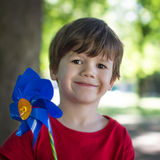 Cute little kid holding windmill Royalty Free Stock Photos