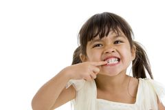 Cute little kid showing her teeth Royalty Free Stock Images