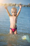 Cute little kid wearing mask and flippers for diving at sand tropical beach. Royalty Free Stock Photos