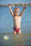 Cute little kid wearing mask and flippers for diving at sand tropical beach. Stock Photos
