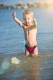 Cute little kid wearing mask and flippers for diving at sand tropical beach. Royalty Free Stock Images