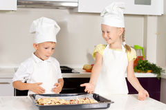 Cute Little Kids Made Pizza on White Table Royalty Free Stock Photo