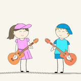 Cute little kids playing with guitar. Royalty Free Stock Image