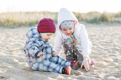 Cute little kids playing in the sand. In the spring time Royalty Free Stock Photography