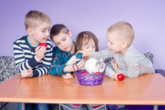 Cute Little Kids Playing With Painted Eggs Stock Images