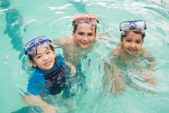 Cute little kids in the swimming pool Royalty Free Stock Photos