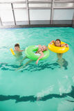 Cute little kids in the swimming pool Stock Photo