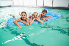Cute little kids in the swimming pool Stock Photos