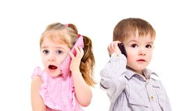 The concept of the modern generation of children. Cute little kids talking on a mobile phone isolated on white background royalty free stock photo