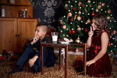 Cute little kids waiting for Santa Claus. In the living room Royalty Free Stock Images