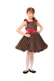 Cute little lady in a brown dress Royalty Free Stock Photography