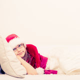 Cute little lady crawling on sofa. Stock Photography