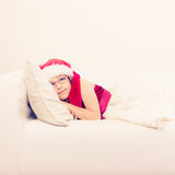 Cute little lady crawling on sofa. Stock Photos