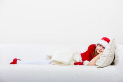 Cute little lady crawling on sofa. Royalty Free Stock Photos