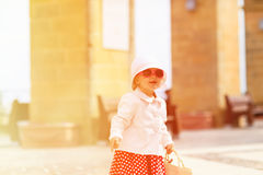 Cute little lady travelling in the city Royalty Free Stock Photo