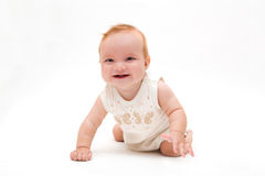 Cute little laughing crawling baby Stock Image