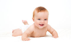 Cute little laughing crawling baby Stock Images