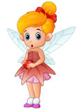 Cute little love fairy holding a heart Stock Photo
