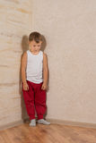 Cute Little Mad Kid on Light Brown Wooden Walls Royalty Free Stock Images