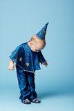 Cute little magician portrait on blue Royalty Free Stock Photography