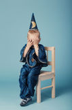 Cute little magician portrait on blue Royalty Free Stock Photo