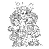 Cute little mermaid girl sits on a stone playing with fish outlined Stock Images