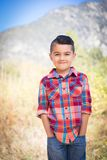 Cute Little Mixed Race Young Boy Standing Outdoors. Mixed Race Young Boy Standing Outdoors royalty free stock photography