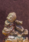 Cute little monk statue Royalty Free Stock Photo