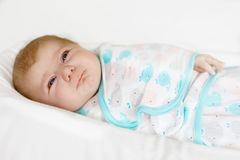 Cute little newborn baby girl crying wrapped in white blanket Stock Photography
