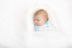Cute little newborn baby girl sleeping wrapped in blanket Stock Image