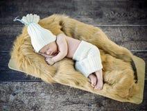 Cute little, newborn child sleeping on the soft blanket Royalty Free Stock Photo
