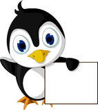 Cute little penguin cartoon holding blank sign