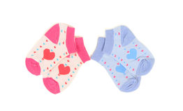 Cute little pink and blue baby socks. Royalty Free Stock Photos