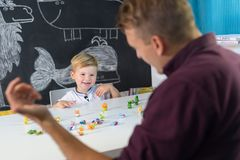 Cute little toddler boy at child therapy session. Royalty Free Stock Photos