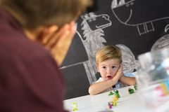 Cute little toddler boy at child therapy session. Cute little playfull toddler boy at child therapy session. Private one on one homeschooling with didactic aids Royalty Free Stock Images
