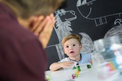 Cute little toddler boy at child therapy session. Stock Images