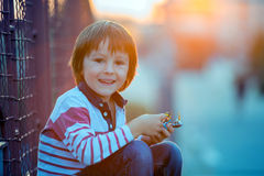 Cute little preschool boy, playing with toys on the street on su Royalty Free Stock Photo