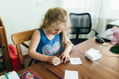 Cute little preschooler child drawing at home.  royalty free stock photos