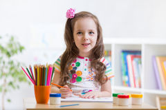 Cute little preschooler child drawing at house Royalty Free Stock Photos