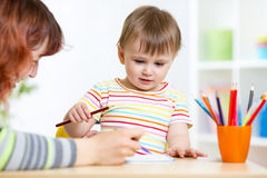 Cute little preschooler child drawing at house Royalty Free Stock Photo