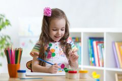 Cute little preschooler child girl drawing color pencils at home or studio. Cute little preschooler child girl drawing at home stock photography
