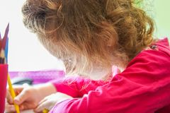 Cute little preschooler child drawing on paper. Cute little preschooler child in process of drawing on paper royalty free stock photo